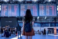 women standing in airport